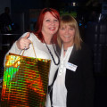 Bottle of Wine and box of Chocolates donated by Cosmos Holidays Presented by Jeanette Ratcliffe to Pauline Dougherty, Travel Counsellors