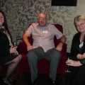 Sharon Earls (left) from Cosmos chats with Ian and Christine Horsewood from Co-Op PTA.