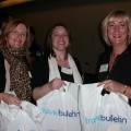 Picking up their goodie bags are, from the left: Cathryn Craven, Yvonne Mackinnon and Christine Edgeller, all from Carrick Travel Limited.