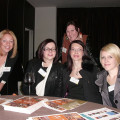 Sarah Wibley (left) and Kate Marsden (standing) from Intrepid chat to, from the left: Laura Smith, Beccy Flint and Laura Shelton from Four Oaks Travel.