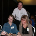 Andrew Sharpe from South Africa Tourism (SAT) shows Katie Duncombe (left) and Stephanie Watson from Holidaysplease one of the new brochures.
