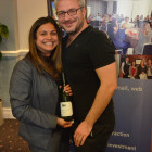 Nisha Tailor Jetset gives Alex Williams ( Blue Skies Travel ) a bottle of wine