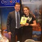 Rachel Murray receives a box of chocolates from Travel Bullletin's Simon Eddolls
