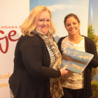 Alaska's Maria Costa Lobo, hands the lucky Nicola Torbell ( Freeway Travel ) her very own Alaska Book!