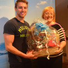 Enjoying the Goody Basket win is Luke Preston from STA Travel York, with New England's Lisa Cooper