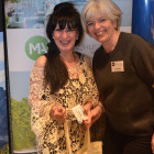 Julie Page ( PTA ), picks up a Massachusetts goody bag from Julie Greenhill.