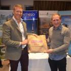 Neil Jones ( Louisiana ) hands the lucky Sonal Hussein from Bridge the World, the Louisiana goody bag.