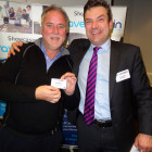 The lucky Alan Beven from Blue Skies Travel wins a Moleskin Notepad, from Simon Eddolls on behalf of Nina Farrimond South African Tourism UK