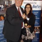 Edward Waite-Roberts (Chandelle Travel) wins a bottle of Champagne with Travel Bulletin's Tasneem Rahman