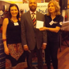Chantell Nel and Nicola Gaunt ( Riviera Travel ) giving Chaminda Boteju's prize ( Peacock Travel )