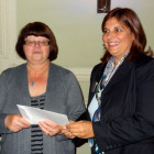 The winner of 2 return flights to Athens with Aegean Airlines Annette Stables, Battersby Travel (left) receives her prize from Lily Alicabiotis of Aegean Airlines.