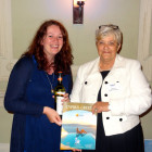 The first winner of a place on a Cyplon Holidays educational and a bottle of wine Emily Webster of STA Travel receives her prize from Jayne Scott, Cyplon Holidays.